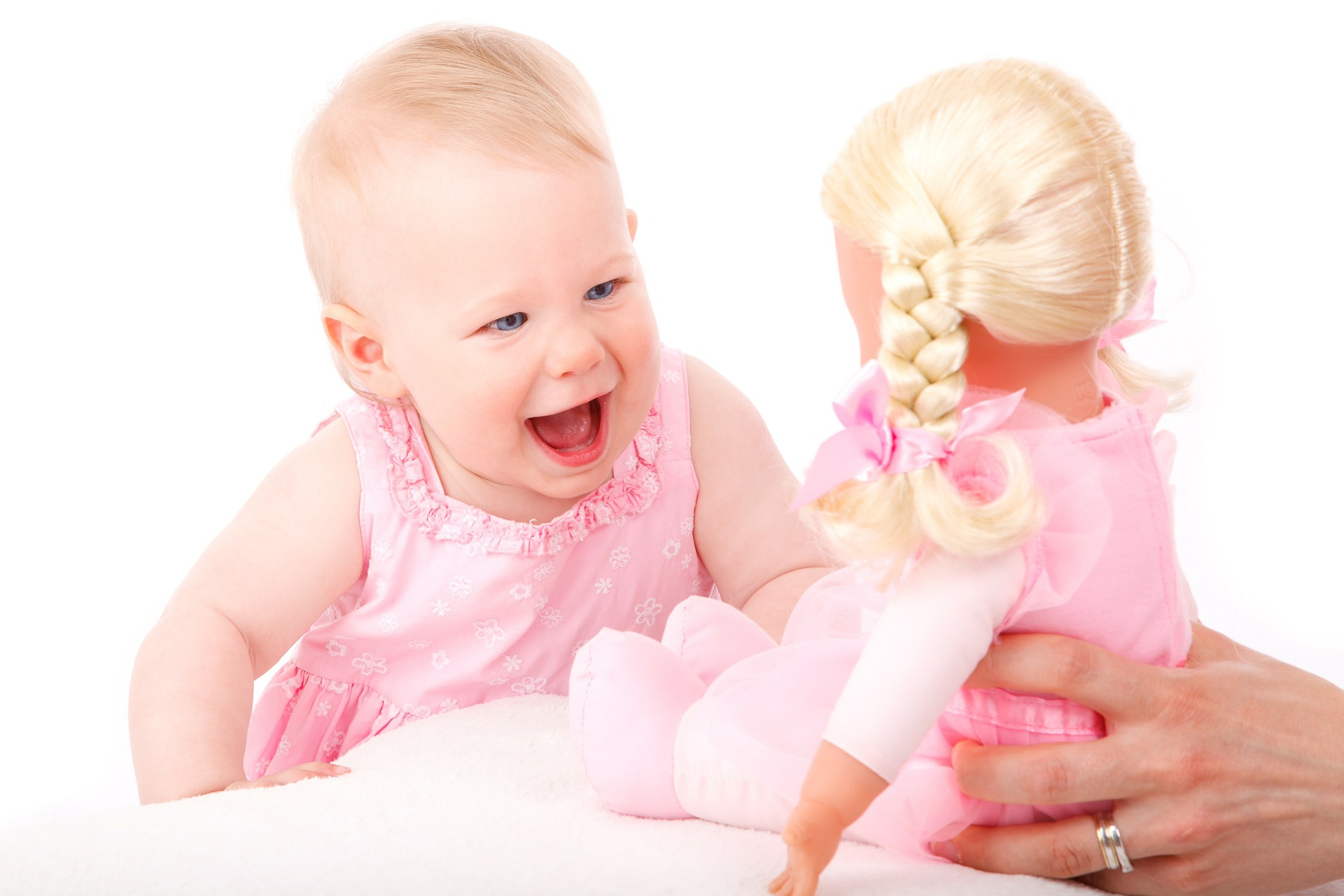 Baby respond to voice and playing with doll